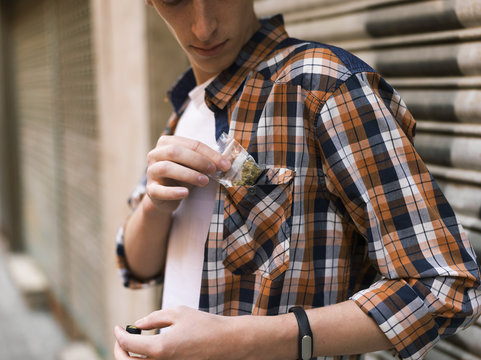 Man putting dope pack to pocket