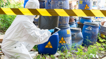 Asian scientist wear Chemical protection suit check danger chemical,working at dangerous zone,authenticating the dangerous chemicals
