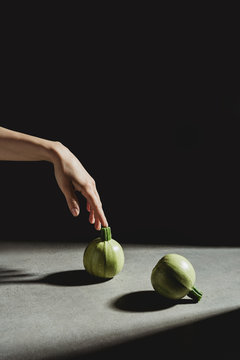 Zucchini and hand