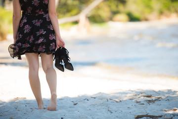 Portrait of a woman walking on the beach