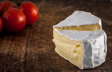 Closeup of brie cheese and cherry tomatoes