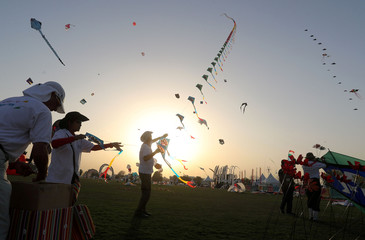 Participants fly kites during an international kites festival in Doha