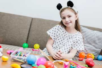 happiness girl kid smile with colorful ball toy on sofa