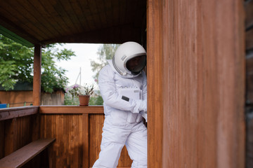 Man in space suit on porch