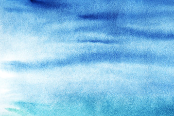 A real watercolor background of the blue sky or the sea. Hand-painted on wet paper