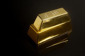 Gold bullion on black background