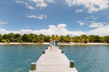 Women Walking on Pier in Belize
