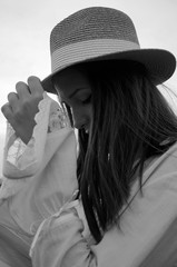 Photo of a young woman holding hat