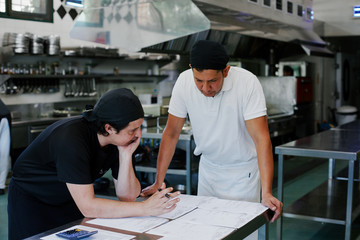 Chef and cook preparing the purchase orders together