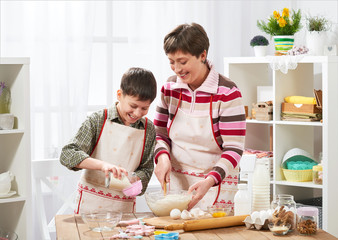 Mother and son cooking at home. Happy family. Healthy food concept