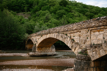 Stone bridge by water