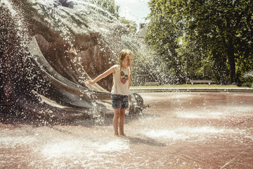 People: Girl having fun in splashing water