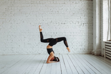The concept of healthy lifestyle and sports. Woman in fashionable sportswear doing exercises.