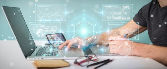 Graphic designer using digital screens interface with holograms datas 3D rendering