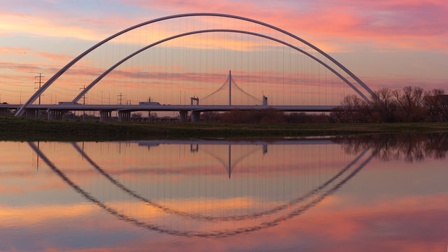 Reflection of Margaret Hunt Hill Bridge and Margaret McDermott Bridge during Sunset from Trinity River, Dallas, Texas