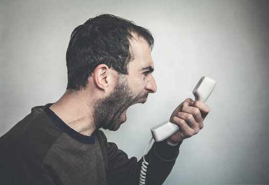 Angry man shouting on phone.