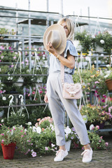 Fashion blogger walking in a small botanical garden