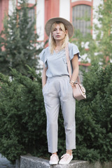 Fashion blogger walking in a small botanical garden
