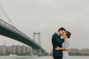 Bride and Groom Kissing Under the Williamsburg Bridge