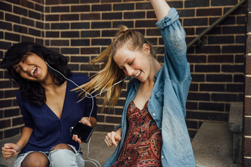 Two Teens Sit and Rock to Music