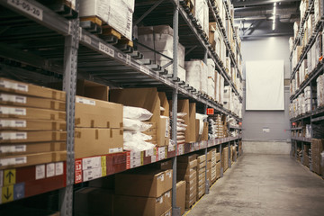 cardboard boxes on shelves