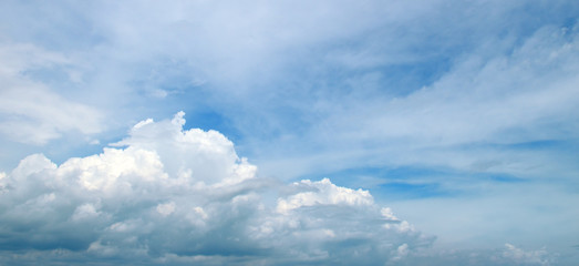 Light clouds in the blue sky. Wide photo.