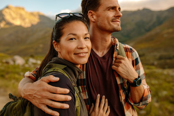 Beautiful asian woman with her boyfriend on hiking trip