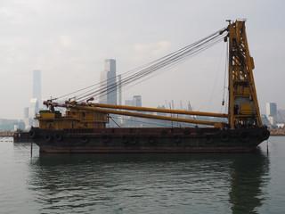 A derrick ship in the Hong Kong harbor.