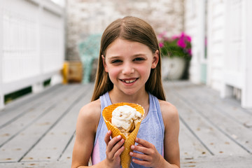 Treat: Young Girl Holds Waffle Cone With Ice Cream