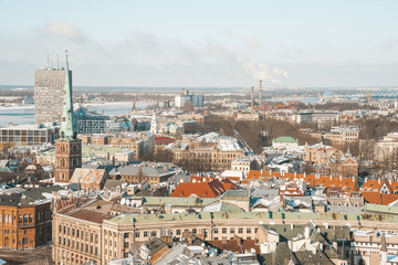 Aerial winter view of the Riga old town from above with a view of river, national library and Dome Cathedral.