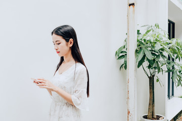 Asian young woman using a cell phone