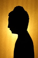 silhouette of buddha head with yellow orange light background. Buddhism india decoration