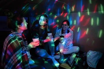 Teens having coffee in van