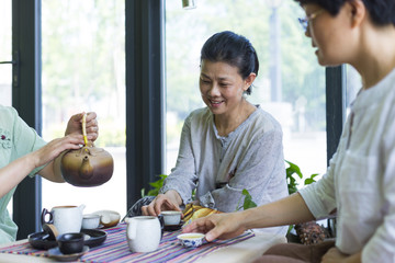 Happy senior asian women drinking tea together