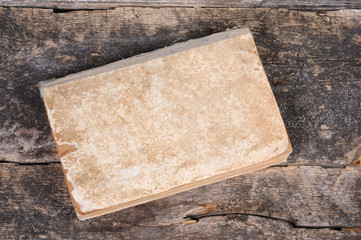 An old shabby book. Front view.