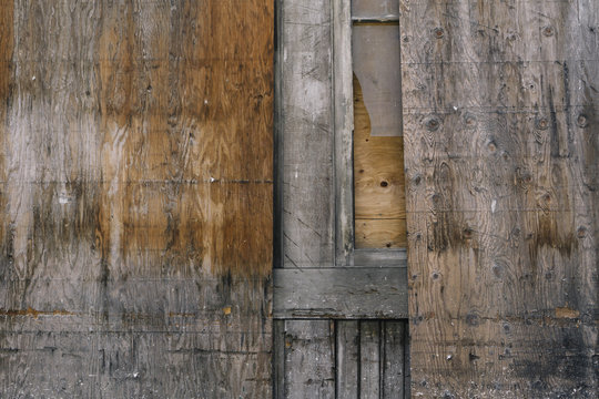 Detail of worn plywood doorway and wall
