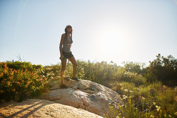 female hiker enjoying nature on hike