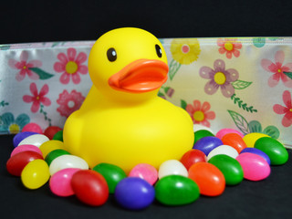 Rubber duck with jelly beans and ribbon