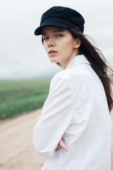 Beautiful cute girl in white blouse