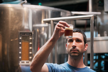 Beer: Brewer Checks Color On Chocolate Stout Beer