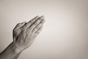 Closeup of hand praying.