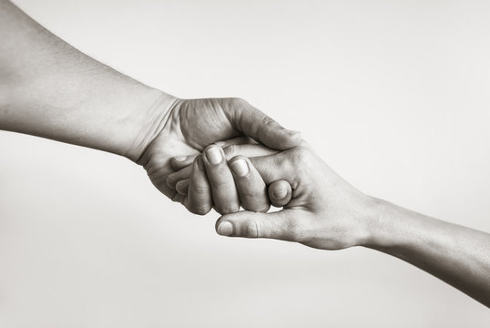 Lending a helping hand. Solidarity, compassion, and charity.
