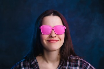 Young beautiful stylish woman in pink vintage sunglasses. Fashion and beauty concept