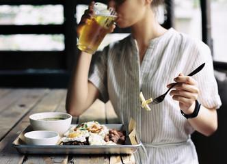 Crop woman drinking beer