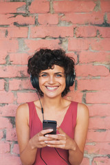 Woman listening to music from mobile phone