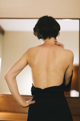 woman in the black dress from behind