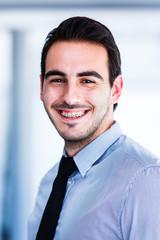 Happy young businessman portrait