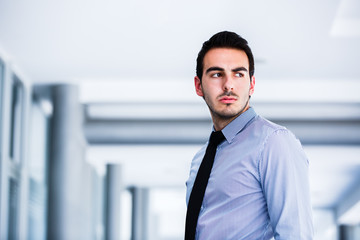 Upset young businessman portrait