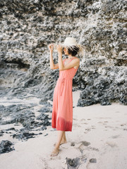 Elegant anonymous woman posing on beach