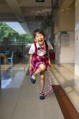 Happy little asian girl in the kindergarten